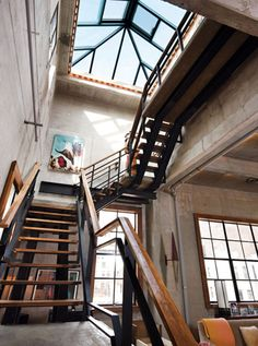 open stairs resting on two support beams... wood and metal rails