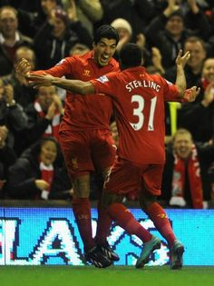 Raheem Sterling celebrates with Luis Suarez after he opens the scoring against Sunderland at Anfield #LFC