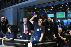 Photo: The Rosetta team at ESA's space operations center in Darmstadt reacts after receiving a signal from the spacecraft. Photo: ESA