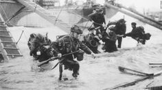 World War II History [D-Day] Troops from the 48th Royal Marines advance to the beach at Saint-Aubin-sur-mer