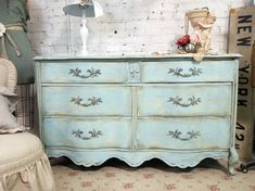 maybe a little brighter of a turquoise color. i've upcycled an old dresser before so i would be on the lookout for a vintage dresser at the goodwill or flea market. much cheaper and can get wonderful results =)