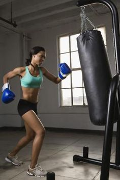 Not only can jabbing and kicking a punching bag give you an immensely powerful take-no-prisoners feeling, it can also help with weight loss. Working with a punching bag boosts coordination, sharpens reflexes and improves flexibility while strengthening your arm, back, core, shoulder and leg muscles. If you have a health condition or injury, consult your doctor before starting any new workout. Also consider exercising with a certified instructor who can properly demonstrate the boxing moves.
