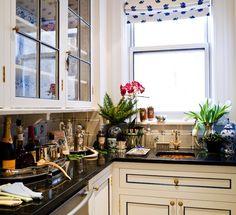 cream colored cabinets. black countertop & black trim.
