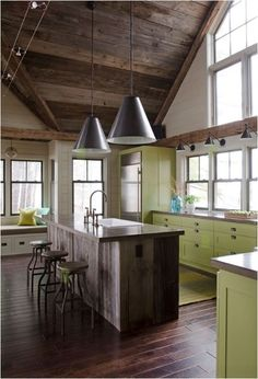 reclaimed wood in kitchen, lights over windows. Windows above the countertop. warm wood floors.