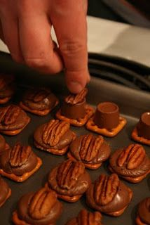 "FOR Christmas time!  Pretzels on a tray, rolo on top, let them get shiny & melty in the oven on low, then press in a pecan.  Easy ""Turtles"""