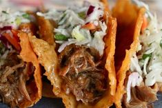 Crispy cheese pulled pork tacos with sesame slaw, sounds amazing!