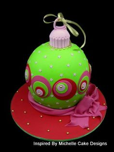 This ball cake had been decorated as a christmas bauble ball. Match your favourite that hangs on your tree. This was made for a christmas raffle and I was in a bright and colourful mood so hot pink and lime green were used in combination with christmas red.