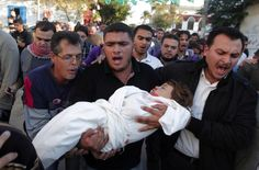 KHAN YUNIS, Gaza Strip— Family members shout in grief as they carry the body of two-year-old Palestinian Walid Abadleh during his funeral. Abadleh was killed in the latest Israeli airstrike on November 15, 2012. (Said Khatib - AFP/Getty Images)