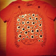 Buy googlie eyes of various sizes from Dollar Tree and have your child stick them to a shirt. Then draw a monster around it. They'll love jumping up and down!