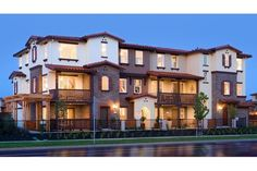 Spanish tile roofs and rustic wood balconies define these new townhomes in the Tavenna community by Pulte Homes in Fremont, California.