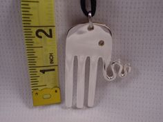 A Spoon Rings Plus Fork Elephant Necklace Silverware Jewelry e14. $20.00, via Etsy.