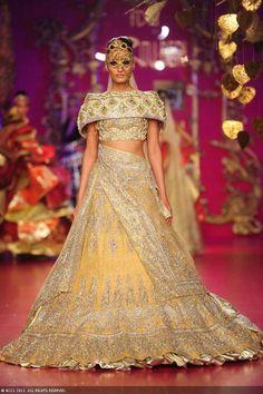 Former Miss India Kanishtha Dhankar walks the ramp for designer Ritu Beri on Day 4 of Delhi Couture Week, held in New Delhi, on August 03, 2013.