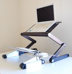 Adjustable, Ergonomic, and Portable Sit/Stand Desk that works with any desk!