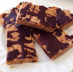 Coconut-Almond Protein Bars shared by nana_lluvia! Makes 12 bars ~ 1/2 cup Perfect Fit Protein, 1/2 cup almond flour, 1/2 cup coconut flour, 1/2 cup peanut butter, 1 tsp vanilla, 2 tsp maple syrup & splash of almond milk until moist. Press into pan w/ parchment paper, place in freezer. Add dark chocolate and 1/2 tbsp coconut oil to a pot over boiling water, stir until melted. Take out the bars and drizzle chocolate on top then place into freezer to set!