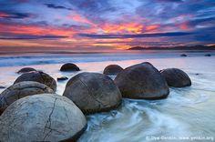 A beautiful image of the Moeraki Boulders in New Zealand.