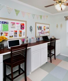 Craft Room Desk Tutorial: build your own craft desk using stock cabinets from Lowe's or Home Depot and laminate flooring for the desktop. Great tutorial here!