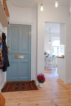 apartment interior, small apartments, entry doors, blue doors, door colors, apartment design, front doors, white interiors, entryway