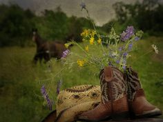 using boots to hold wild flowers... little touches of country