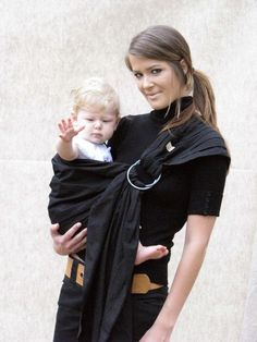 I want a ring sling for carrying J on my hip like this. I like this simple black one.