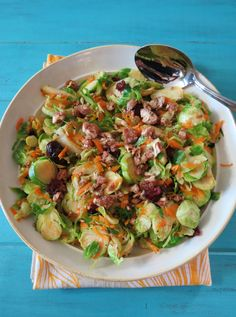 Fall Harvest Brussels Sprouts - A sweet and savory Fall side dish made with sauteed Brussels Sprouts, pears, candied pecans and dried cranberries.