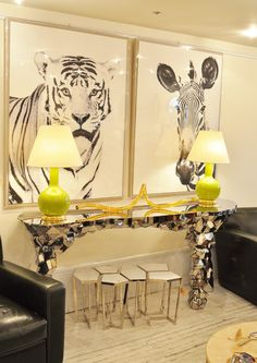 Abstract #stainless #steel #console with black and white #tiger and #zebra #photographs vignette at #NYC #Mecox #interiordesign #NewYork #MecoxGardens #furniture #shopping #home #decor #design #room #designidea #vintage #antiques #garden