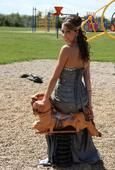"""Graduate- photographed at her elementary school's playground. Such memories of this being the """"big kid"""" playground."""