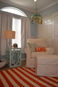 This gorgeous orange and white striped rug adds such a pop of color!