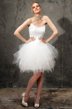 all about the short wedding dress. love her necklace too