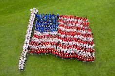 Elementary school students work together to celebrate Flag Day.