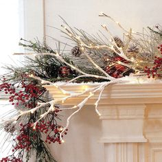 White winter branches with lights berri, mantel, ana rosa, winter white christmas decor, holiday idea, winter branches, light, willow branch, christmas mantles