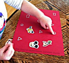 Learning Letters and Shapes with Stickers Fine Motor Activity from The Stay-at-Home-Mom Survival Guide