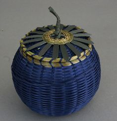"""Native American Baskets by Pam outdusis Cunningham at Home & Away Gallery. Medium Sweetgrass and Ash Blueberry Basket by Pam outdusis Cunningham,  Penobscot. A charming blueberry basket, woven from brown ash with sweetgrass rim and finial. (Read about the artist: """"I love every aspect of my basket making...) 6"""" high x 4"""" diameter"""
