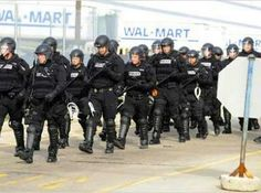 Walmart called riot police on the peaceful gathering.  The police streamed into the area in full riot gear, as though they were preparing to do battle with a vicious, angry mob rather than a peaceful group of spiritual leaders and community supporters. With batons at the ready, the militarized forces stood inches from each placid protester as they sat down in the road, singing songs and chanting for solidarity and justice.
