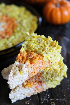 Candy Corn Rice Krispie Treats!  SO EASY and the perfect treat to bring to any Halloween themed party
