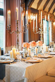 The head table featured candelabras and garden roses, ranunculuses, and peonies in mirrored vases. Photo by Avery House. Pretty color scheme #wedding #reception