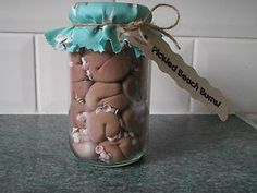 pickled Beach Bums!!  individually hand crafted bums layered with shells crammed into a glass jar with a seaside themed fabric lid.