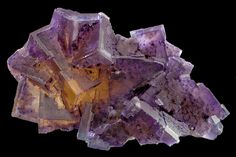 Cluster of purple and golden Flyorite cubes