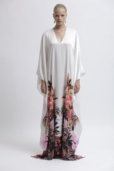 Badgley Mischka caftan-style maxi dress in white with an exotic shimmering bottom floral print. Full sleeves flow into fluttering sides. Pre Spring 2013-Vogue.it