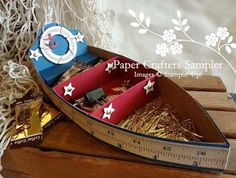"""Row-ya boat desktop caddy.  The new Display Rowboat from the May issue of the Paper Crafters Sampler, """"Tribute to Dad""""."""