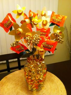 Reese's bouquet made by me and a friend.  Reese's pieces in fill the vase topped with mini Reese's cups. Flowers made out of various colored paper with mini Reese's  cups in the middle taped with skewers. Just make a bouquet with your friends favourite candies!