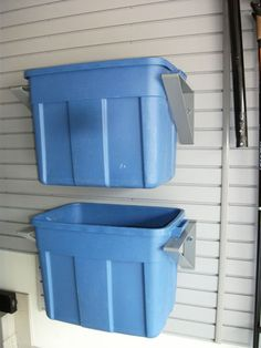 VersaTrac Slatwall garage storage system----this would be great for the recycle tubs. We could just attach brackets to the wall.