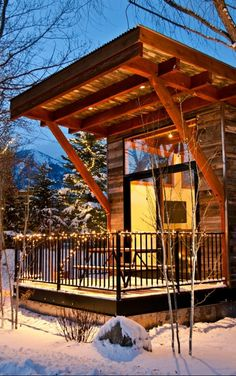 Cozy up in a Jackson Hole cabin. They feel rustic but have all of the modern amenities, including rain showers.