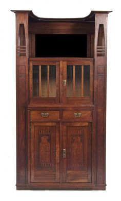 An English Arts & Crafts Walnut Cabinet, Height 7