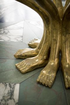 May 2013 Issue - A table base resembling a group of feet