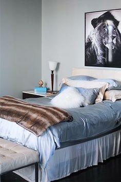 Peep this interior designer's Chelsea pad interior, lion photo, blue, cozy beds