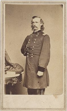 Napoleonic pose by Brigadier General George A. Custer for this Brady Studio CDV portrait.