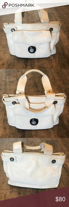 Michael Kors Cream Leather Handbag Satchel style bag in beautiful supple cream leather with black accents. Black interior lining. Interior contains one larger side zipper pocket and four additional pockets for phone, keys, etc. Bag is in great condition. There are a few tiny imperfections, just from being used but nothing even notable enough for a photo except small knick on handle (pictured). 💯 authentic!! Michael Kors Bags Satchels