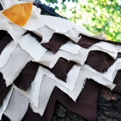 It's a bird, it's a plane, it's Fine Feathered Falcon Wings. This gorgeous costume idea is homemade, believe it or not. Homemade Halloween costumes for kids have never looked this fly.