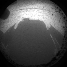 This is one of the first images taken by NASA's rover, Curiosity. Taken with the rover's Hazcam cameras, the image shows rocks, dust, and the rover's shadow on the surface of Mars.
