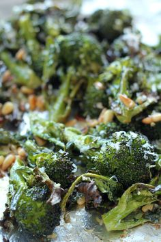 Barefoot Contessa roasted broccoli with lemon, pine nuts, garlic, and parmesan. So delicious!!!